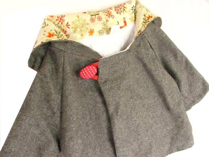 Grey jacket spotty button